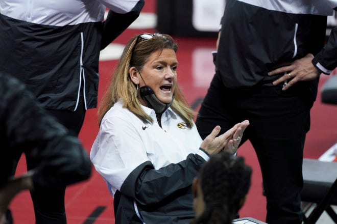 Missouri coach Robin Pingeton talks with players in a timeout during a game against South Carolina on Feb. 11 in Columbia, S.C.