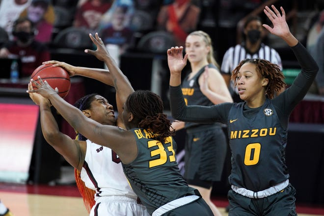 South Carolina forward Aliyah Boston, left, is defended by Missouri's Aijha Blackwell (33) and LaDazhia Williams (0) during a game Thursday night in Columbia, S.C.