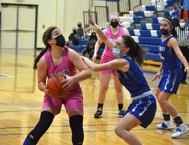 Inland Lakes sophomore guard Natalie Wandrie (left) prepares to take a shot over Gaylord St. Mary's Bailey Murrell during the second half of a varsity girls basketball matchup in Indian River on Thursday.