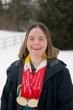 Special Olympics athlete Jessica Komjati, at her home in New Albany, had a bucket of ice water poured on her head as part of this year's virtual Polar Plunge.