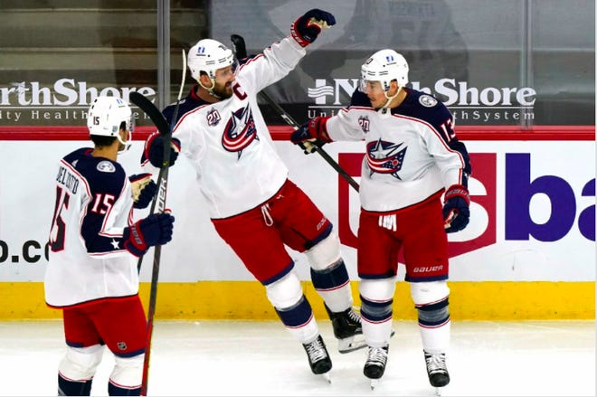 Cam Atkinson (13) celebrates his goal with Nick Foligno, middle, and Michael Del Zotto (15) in the first period of the Blue Jackets' 6-5 victory against the Chicago Blackhawks on Thursday night at United Center. Atkinson also assisted on three goals and finished with four points.
