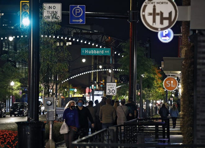 Despite a record high number of COVID-19 cases in Ohio on Oct. 15, 2020, residents were still heading out to bars and restaurants along North High Street in Columbus' Short North.