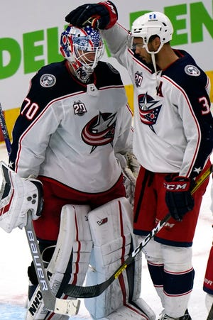 The vibe from Blue Jackets goaltender Joonas Korpisalo (70) and defenseman Seth Jones was more about relief than celebration after Columbus rallied for a 6-5 victory in Chicago on Thursday.