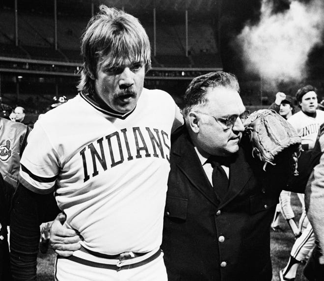 Cleveland Indians pitcher Len Barker , left, is escorted off the field by security guard Gus Farone after Barker's perfect game against the Toronto Blue Jays on May 15, 1981.
