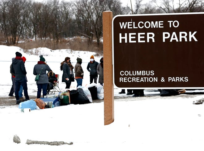 Advocates for the homeless gather to hand out tents and other supplies at Heer Park. The city is temporarily closing Heer Park because of vandalism, drugs and other illegal activity. Advocates say this will ultimately prevent them from helping people in the homeless community, who go to the park to get needed supplies.
