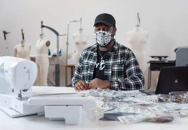 "While inside his work area at the Idea Foundry in Franklinton, Columbus fashion designer Kevin Black wears one of the masks he created for the Columbus Fashion Alliance's ""Slay Safe"" campaign featuring masks from six different local designers."