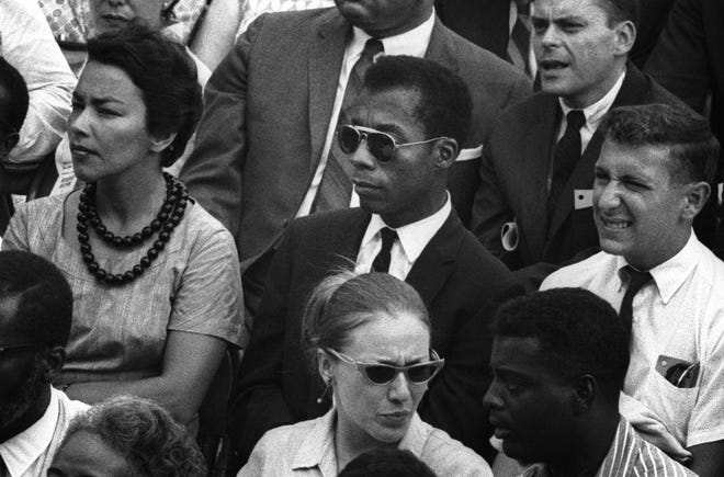 """Writer James Baldwin, center, in """"I Am Not Your Negro,"""" a movie that will be discussed Feb. 24 as part of Columbus Metropolitan Library's Speak Up/Speak Out series."""