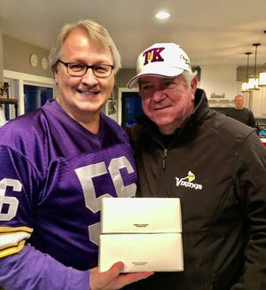 Jeff Dufault presented Tommy Kramer with two boxes of Widman's candy from Crookston, one full of Chippers and another with turtles.