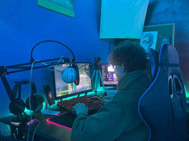 Bryce Ceculski competes in eSports competition from his gaming lab.