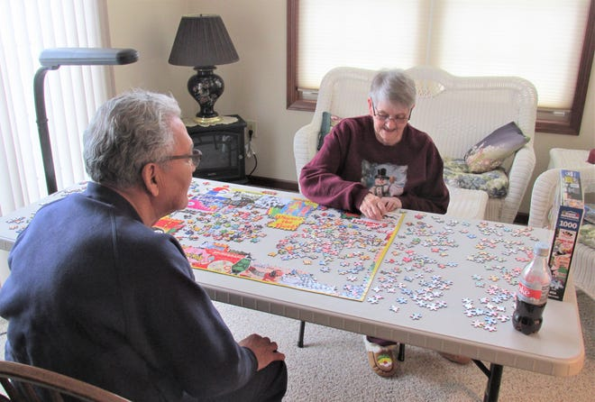 Bonnie and Bill Agawa of Millersburg are among the many folks who find building a jigsaw puzzle a fun way to wile away the hours during the pandemic.