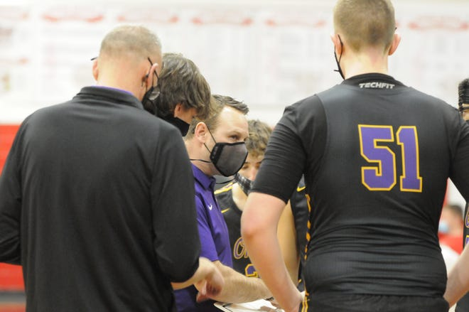 Onsted head coach Brad Maska talks to his team during a timeout in a game against Clinton in the 2021 season.