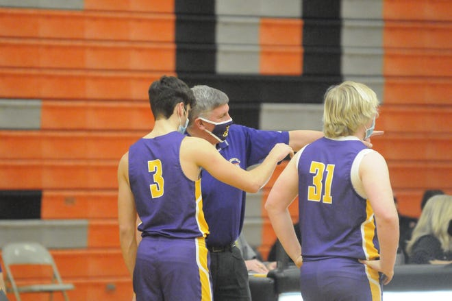Blissfield head coach Gary Sullivan talks to Nolan Savich (3) and Chase Collyer (31) during Thursday's game at Hudson.