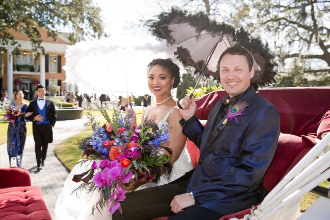 Newlyweds in carriage ride to reception.