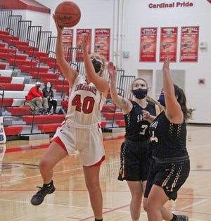 Coldwater's Brooke Moore (40) drives in for two of her 14 points in the Cardinals win over Hastings Thursday.