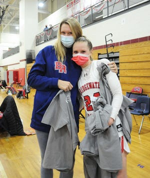 Bridgewater-Raynham teammates from left, Shay Bollin and Kenzie Matulonis, at the conclusion of their game versus  New Bedford, on Thursday, Feb. 11, 2021.