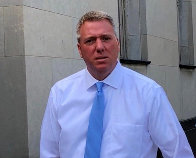 Former Lakeside Chevrolet finance manager Chad Bednarski, seen in this August 2019 photo before his initial appearance on federal fraud charges, was sentenced on Friday to serve two years and eight months in federal prison.