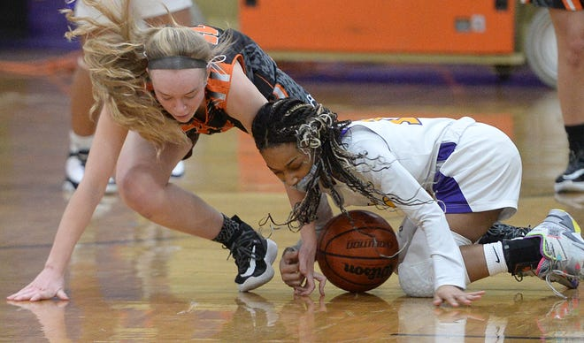 Harbor Creek's Lily Pulvino, left, battles for a loose ball with Erie High's JyNaiza Selby in the District 10 game Thursday at Erie High School.