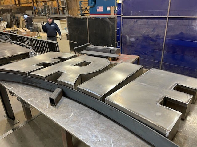 """This 10-foot-wide, 5-foot-high """"Erie"""" sign, created by local metal fabricating company Gene Davis Sales and Service, will be erected soon on the west bayfront bluff at Bayview Park near the foot of Cherry Street."""
