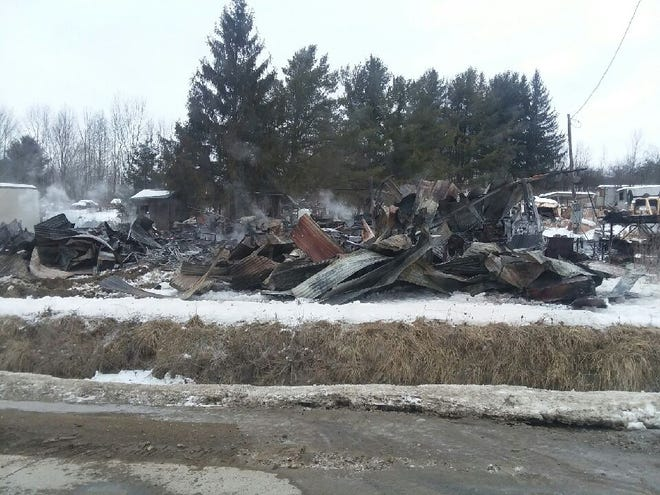 Smoke rises from the burned debris of a fatal overnight fire in the town of West Almond on Friday, Feb. 12, 2021. New York State Police said one person was killed in the residential blaze.