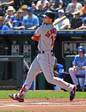 Andrew Benintendi said one of his favorite parks to play in was Kauffman Stadium. Now it will be his home field after Boston traded him to the Royals late Wednesday night.