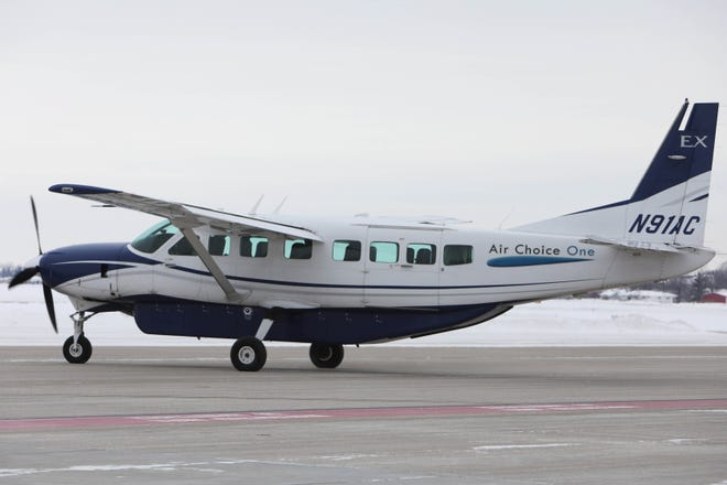 An Air Choice One aircraft departs Thursday from the Southeast Iowa Regional Airport in Burlington for Chicago.