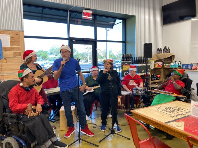 The Flashbacks perform at Lucky's Market in December 2019. The pops band features clients of the Pine Castle training and activity center for adults with intellectual and developmental differences.