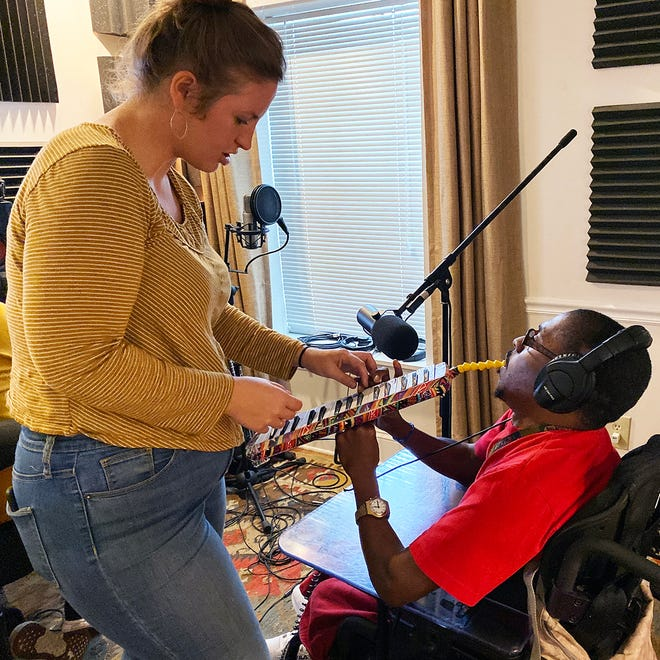 Music Director Abigal Gruber and The Flashbacks band member Vanton practice on the melodica. The special-needs pops band features clients of the Pine Castle center for adults with intellectual and developmental differences.