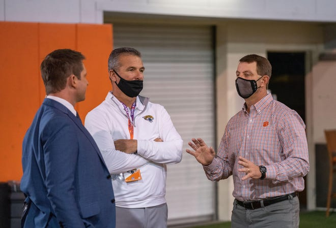 Feb 12, 2021; Clemson, SC, USA; Jacksonville Jaguars head coach Urban Meyer (middle) talks with Clemson Tigers head coach Dabo Swinney (right) as quarterback Trevor Lawrence (not pictured) works out during Pro Day in Clemson, South Carolina. Mandatory Credit: David Platt/Handout Photo via USA TODAY Sports