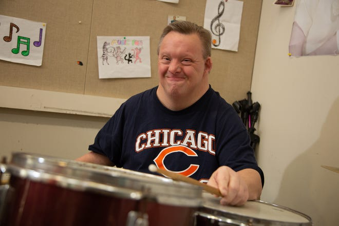 Larry, a member of the The Flashbacks special-needs pops band, shows his joy in performing.
