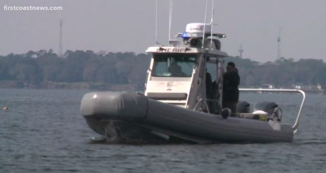 A police search boat looked for the missing fisherman on Feb. 4 near the Buckman Bridge.