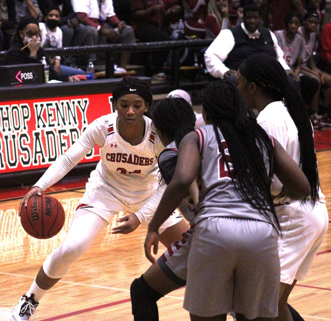 Bishop Kenny forward Jasmyne Roberts (24) dribbles against the Raines defense during a Florida High School Athletic Association Region 1-4A girls basketball quarterfinal on February 11, 2021. [Clayton Freeman/Florida Times-Union]