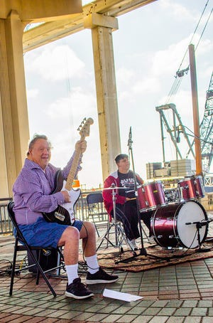 Larry (left) and Alex perform at the Riverside Arts Market in 2019 as part of the special-needs pops band The Flashbacks.
