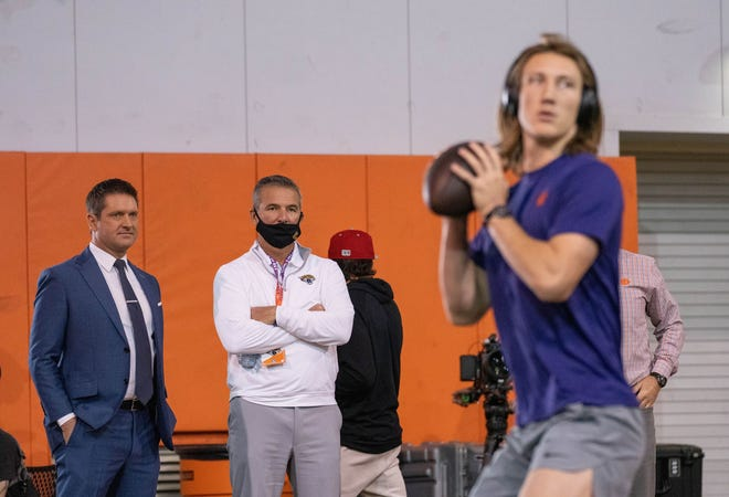 Feb 12, 2021; Clemson, SC, USA;  Jacksonville Jaguars head coach Urban Meyer (middle) watches as Clemson Tigers quarterback Trevor Lawrence works out during Pro Day in Clemson, South Carolina. Mandatory Credit: David Platt/Handout Photo via USA TODAY Sports