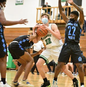 Gastonia city rivals Hunter Huss and Ashbrook met in a Big South 3A basketball doubleheader on Thursday, Feb. 11, at Ashbrook High's Larry Rhodes Gymnasium in Gastonia. [JOE L. HUGHES II/Gaston Gazette]