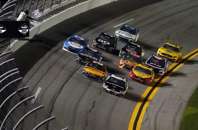 Aric Almirola races to win Duel 1 at Daytona International Speedway on Thursday night, Feb. 11, 2021. The Duel at Daytona races help set the starting field for the Daytona 500.