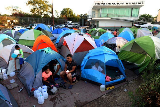 Migrants from Central America and Mexico await the outcome of their U.S. immigration court cases in a tent encampment near the Gateway International Bridge at the U.S.-Mexico border in Matamoros, Tamaulipas, on Oct. 1, 2019.