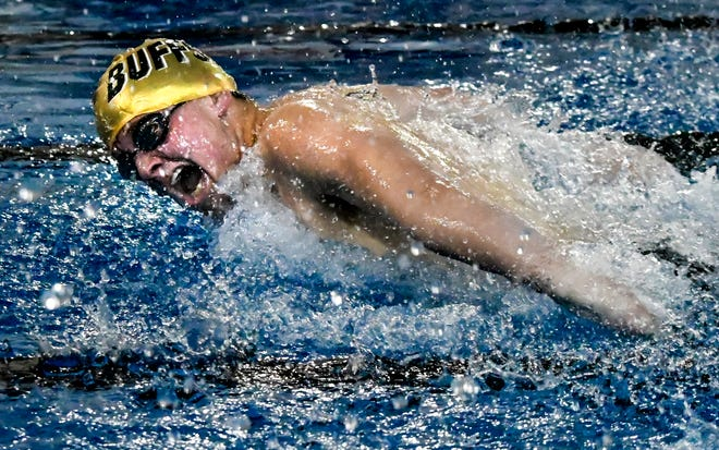 Garden City High School's Connor Cupp comes up for a breath and makes a stroke in an 100 butterfly race Feb. 4 at the Garden City Family YMCA.  Cupp won the event Thursday at the WAC meet in Great Bend and was chosen as this year's WAC Outstanding Swimmer.
