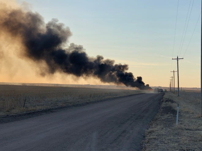 An oil field tank battery burns Thursday evening south of Hays on Grants Villa Road, a quarter mile west off US-183 highway.