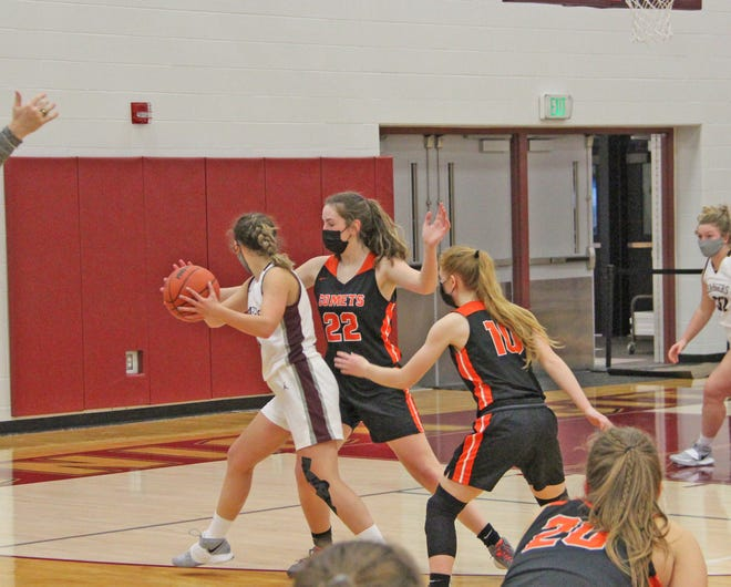 The Comet duo of Natalie Doyle (22) and Emma Rounds (10) look to trap a Union City ball handler in early season play.