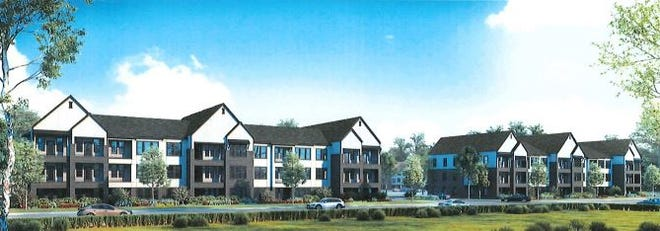 An artist rendering shows plans for designs for a proposed apartment complex on Gallagher Drive. The complex will be built on the former site of a specialty hospital.