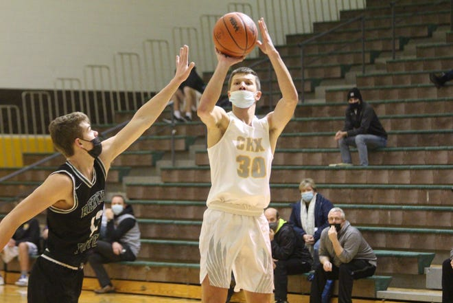 Zeeland East's Trip Riemersma goes up for a jump shot  during their win over Reeths-Puffer on Thursday, Feb. 11, 2021