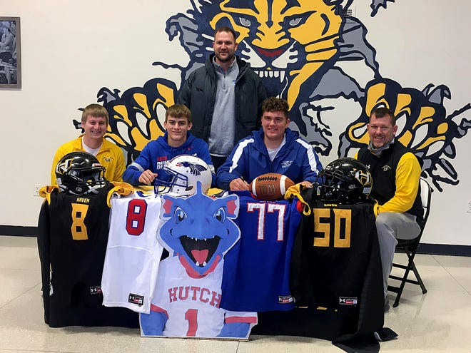 Haven High School's Darby Roper, left, and Hunter Barlow signed on to continue their academic and football careers at Hutchinson Community College. Haven head football coaches are Thomas Cooprider, left and Drew Thalmann, right, with HCC head football coach Drew Dallas, back.