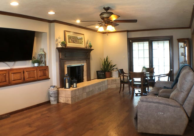 The family room/den with a fireplace and big-screen television is one feature of Aster Estates, a new assisted living facility in Great Bend licensed for seven residents.