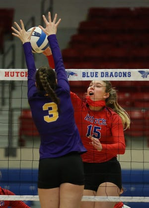 Hutchinson's Kristina Head (15) spikes the ball past Dodge City's Sina Toroslu (3) during their match Thursday evening at the Sports Arena. HCC won over Dodge City 25-5, 25-13, 25-15.