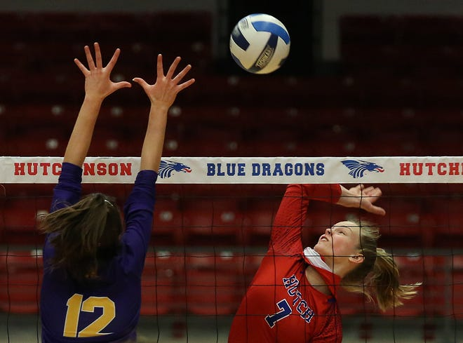 Hutchinson's Shadee Briggs (7) spikes the ball against Dodge City's Maria Alcantara (12) during their match Thursday evening at the Sports Arena. HCC won over Dodge City 25-5, 25-13, 25-15.