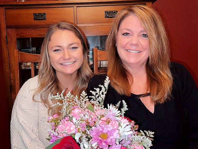 Maggie Sosnowski and her mother, Christy, hold flowers from Deininger Floral Wednesday, Feb. 10, 2021, as the duo get ready to celebrate Valentine's Day and Maggie's 18th birthday. Valentine's Day has been extra special each year for mother and daughter.
