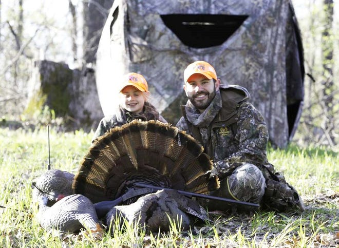 Hailey Hindman, age six, and her dad Jake Hindman on a turkey hunt during youth weekend. This was Hailey's first turkey.