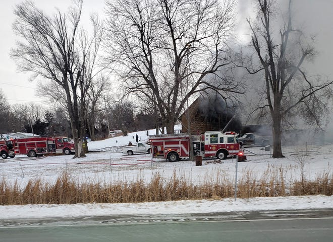 Firefighters respond to a house fire Thursday at U.S. 73-Kansas 7 Highway and Easton Road.