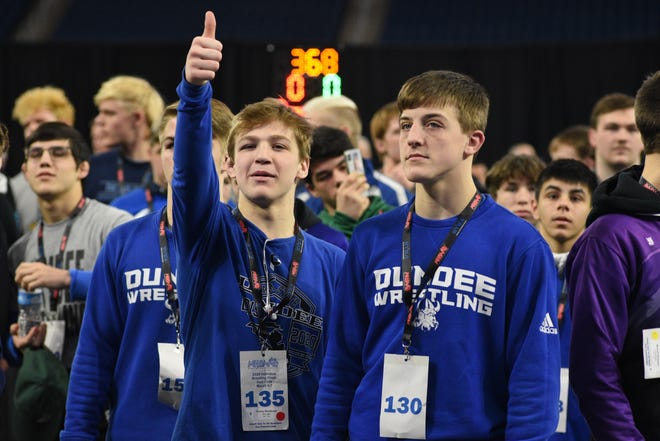 Casey Swiderski (left) and Austin Fietz of Dundee line up for the Grand March before the individual state wrestling finals at Ford Field in Detroit last season. Those two won state titles Saturday along with teammates Braeden Davis, Christian Killion, Tyler Swiderski, Dominick Lomazzo and Stoney Buell. [Monroe News photo by TOM HAWLEY]