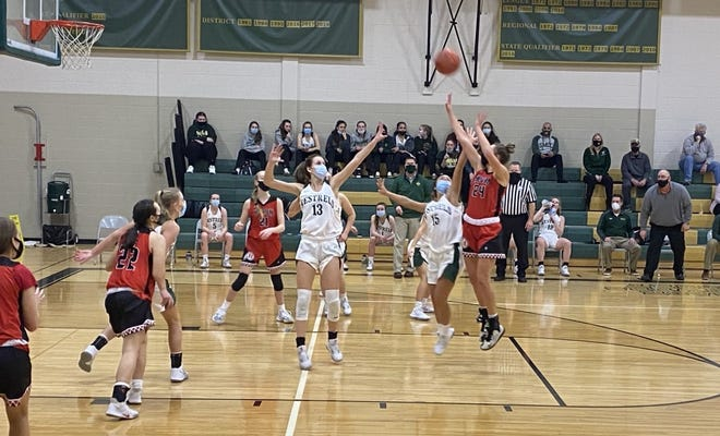Lexi Thomas of New Boston Huron shoots over Isabelle Alston (13) and Jenna Kapp of St. Mary Catholic Central during a 49-46 SMCC win Thursday night. [Photo courtesy of Gabrielle Alston]